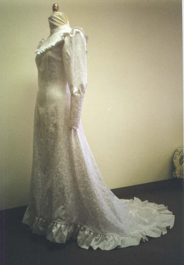 Hawaiian wedding gowns holuku slide show for Hawaiian wedding dresses with sleeves